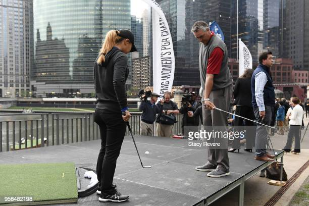 Danielle Kang and former Chicago Bulls player Toni Kukoc participate in a closet to the pin competition at the KPMG Women's PGA Championship National...
