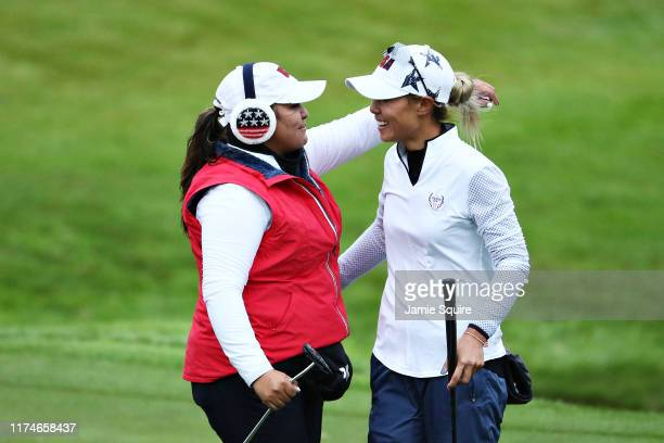 Danielle Kang and Lizette Salas of Team USA celebrate winning their match on the seventeenth hole during Day 2 of the Solheim Cup at Gleneagles on...
