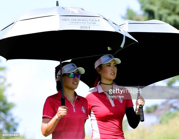 Danielle Kang and Michelle Wie of the United States leaves the ninth tee during the afternoon fourball matches of the Solheim Cup at the Des Moines...