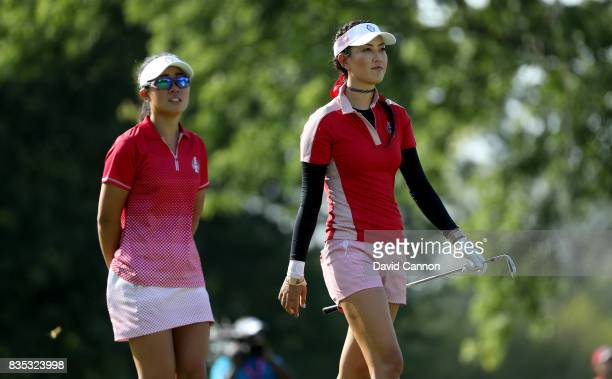 Danielle Kang and Michelle Wie of the United States Team on the 12th hole in their match against Jodi Ewart Shadoff and Madelene Sagstrom of the...