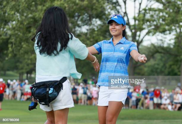 Danielle Kang celebrates with her mother Grace Lee after her birdie putt on the 18th green to win the 2017 KPMG Women's PGA Championship at Olympia...