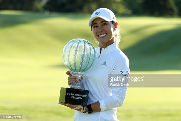 Danielle Kang celebrates with the trophy on the 18th green after her 7 under par final round victory in the LPGA Drive On Championship at Inverness...