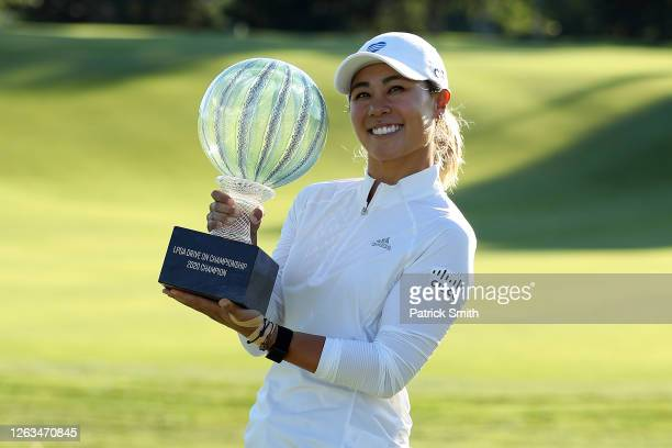 Danielle Kang celebrates with the trophy on the 18th green after winning the LPGA Drive On Championship at Inverness Club on August 2 2020 in Toledo...