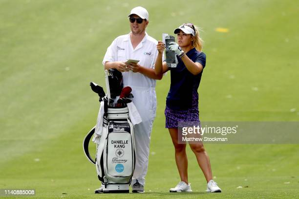 Danielle Kang confers with her caddie Oliver Brett in the fourth fairway during round 3 of the ANA Inspiration on the Dinah Shore course at Mission...