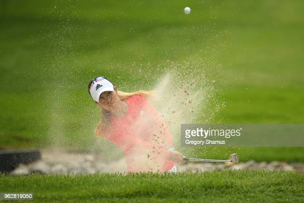 Danielle Kang hits from a bunker to the fourth green during the third round of the LPGA Volvik Championship on May 26 2018 at Travis Pointe Country...