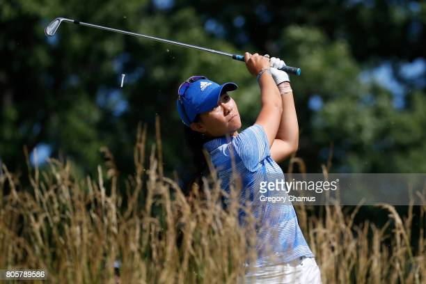 Danielle Kang hits her tee shot on the 15th hole during the final round of the 2017 KPMG PGA Championship at Olympia Fields Country Club on July 2...