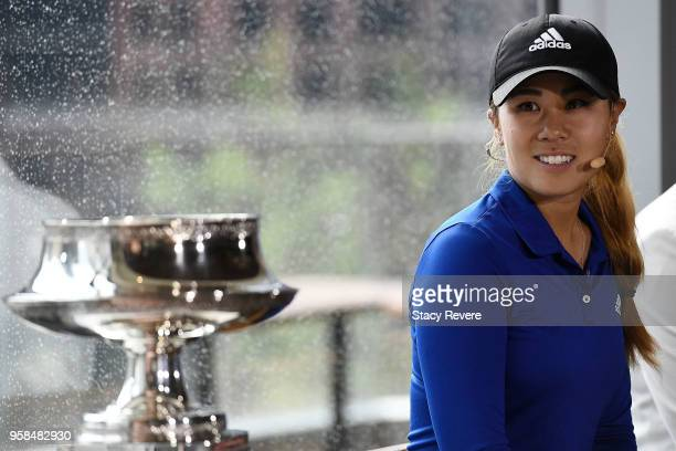 Danielle Kang looks at the championship trophy during the KPMG Women's PGA Championship National Media Day in River Point Park on May 14 2018 in...