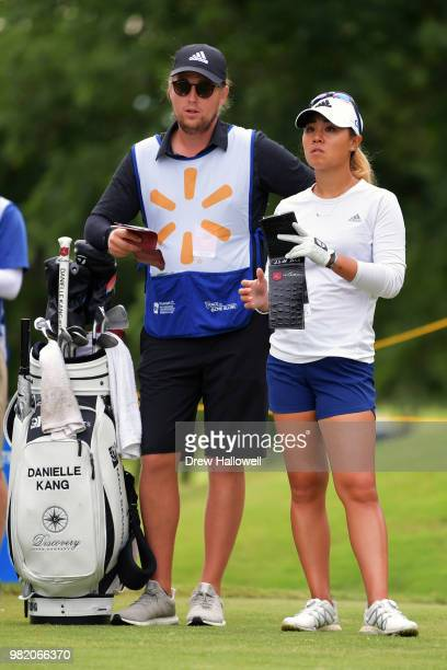 Danielle Kang looks on with her caddie on the third hole during the second round of the Walmart NW Arkansas Championship Presented by PG at Pinnacle...