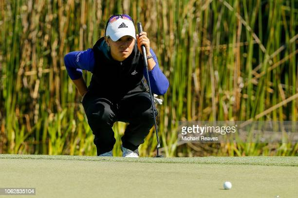 Danielle Kang looks over a putt on the eighth green during the third round of the LPGA CME Group Tour Championship at Tiburon Golf Club on November...