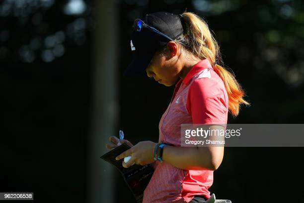 Danielle Kang marks her score card next to the sixth green during the first round of the LPGA Volvik Championship on May 24 2018 at Travis Pointe...