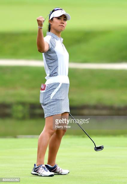 Danielle Kang of Team USA celebrates her birdie putt to win the third hole during the morning foursomes matches of the Solheim Cup at the Des Moines...