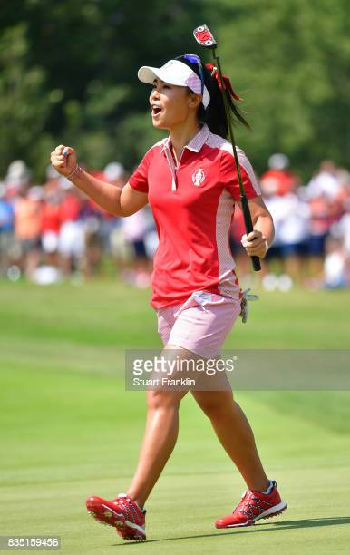 Danielle Kang of Team USA celebrates holeing the winning putt during the morning foursomes matches of The Solheim Cup at Des Moines Golf and Country...