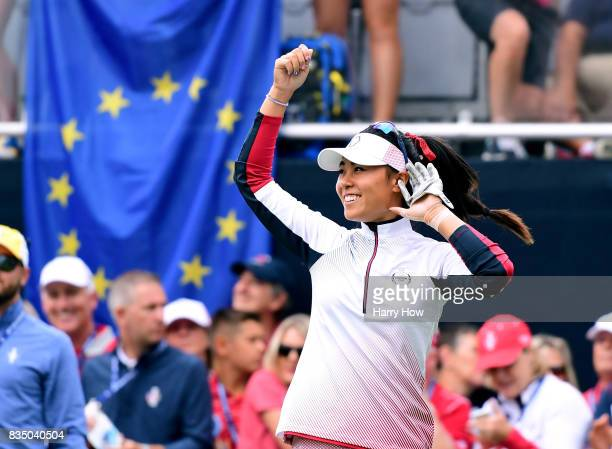 Danielle Kang of Team USA plays with the crowd on the first tee during the morning foursomes matches of the Solheim Cup at the Des Moines Golf and...