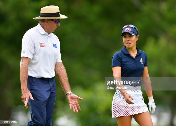 Danielle Kang of Team USA talks with her coach David Leadbetter during practice prior to The Solheim Cup at Des Moines Golf and Country Club on...