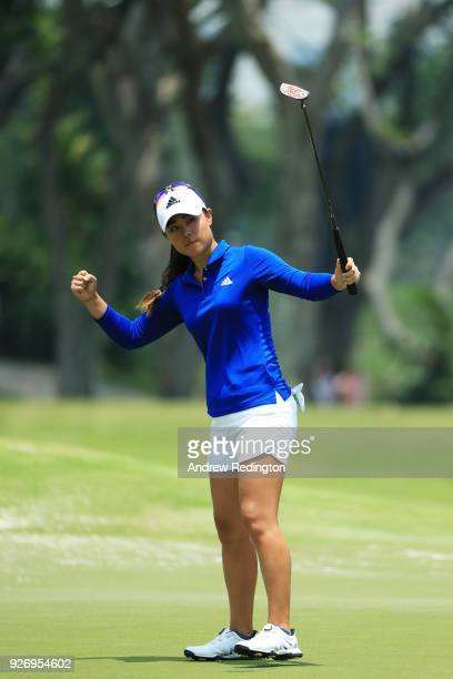 Danielle Kang of the United States celebrates after saving par on the 12th green during the final round of the HSBC Women's World Championship at...