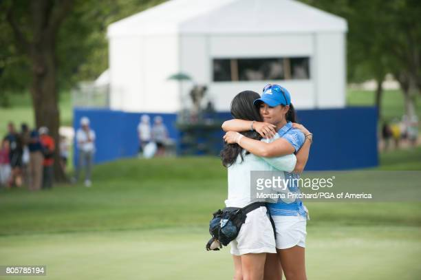Danielle Kang of the United States hugs her mother on the 18th hole during the Final Round for the 2017 KPMG Women's PGA Championship held at Olympia...