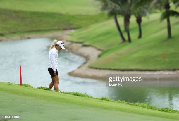 Danielle Kang of the United States looks for her ball on the eighth hole during the third round of the HSBC Women's World Championship at Sentosa...
