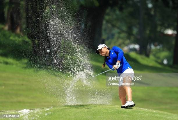Danielle Kang of the United States plays her third shot on the 12th hole during the final round of the HSBC Women's World Championship at Sentosa...