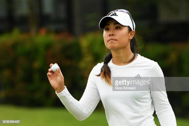 Danielle Kang of the United States reacts on the fifth green during round two of the HSBC Women's World Championship at Sentosa Golf Club on March 2...