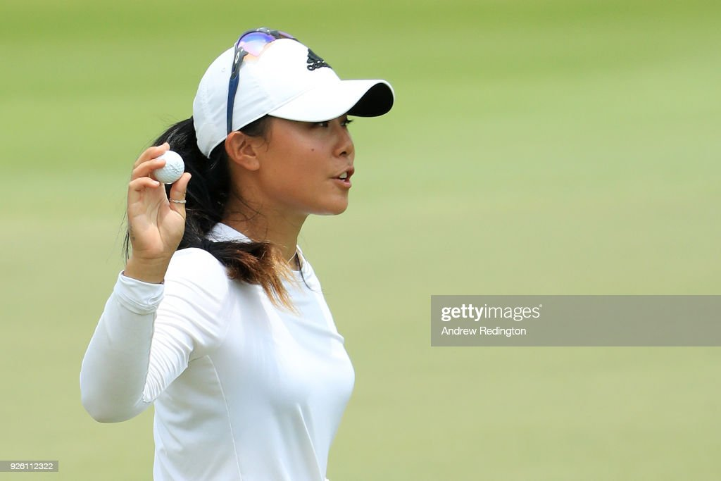 Danielle Kang of the United States reacts to her birdie on the 18th green during round two of the HSBC Women's World Championship at Sentosa Golf Club on March 2, 2018 in Singapore.