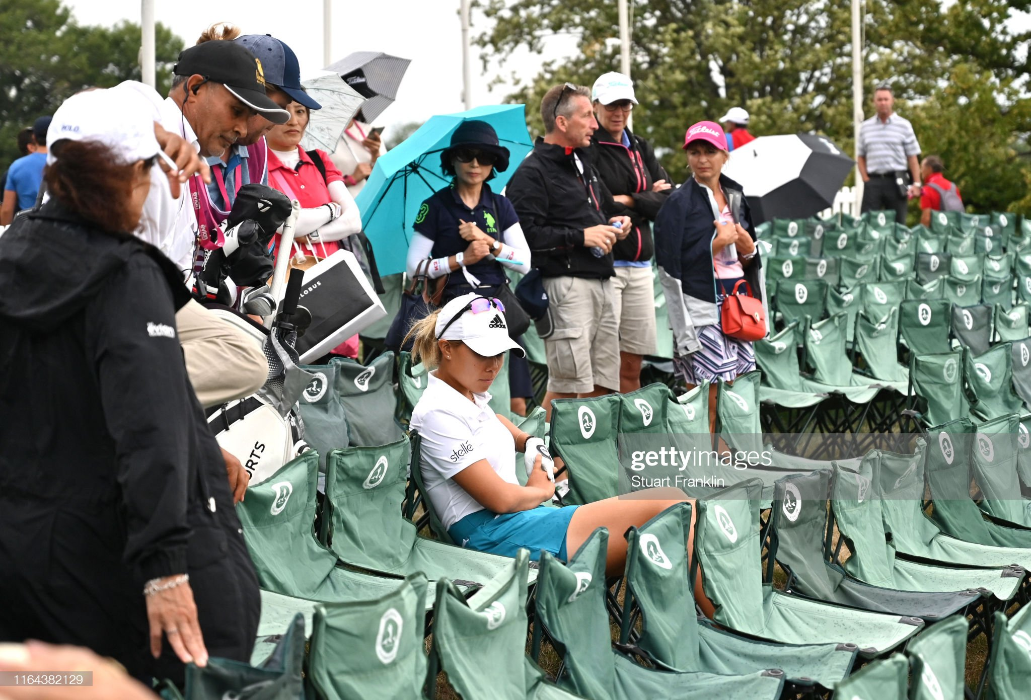 https://media.gettyimages.com/photos/danielle-kang-of-the-united-states-takes-a-seat-on-the-18th-as-her-picture-id1164382129?s=2048x2048
