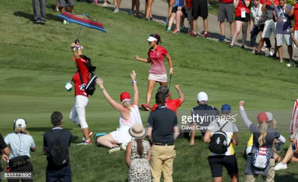 Danielle Kang of the United States Team celebrates a birdie on the 12th hole in her match with Michelle Wie against Jodi Ewart Shadoff and Madelene...