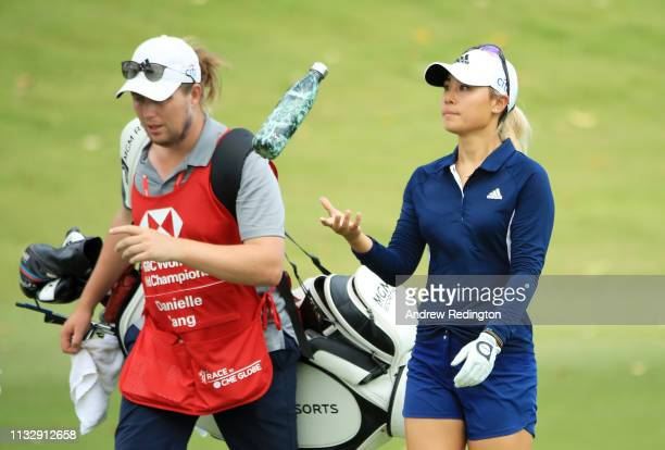 Danielle Kang of the United States walks with her caddie Ollie Brett on the 18th hole during the second round of the HSBC Women's World Championship...