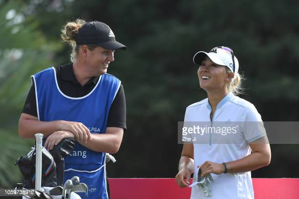 Danielle Kang of United States smiles with her caddie during the final round of the Blue Bay LPGA on November 10 2018 in Hainan Island China