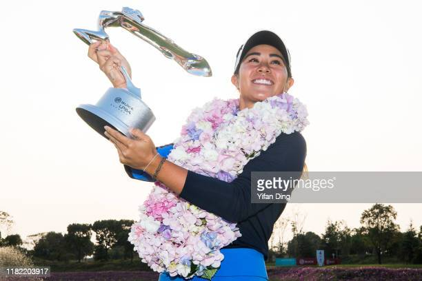 Danielle Kang of USA poses for photoshot with the trophy after winning 2019 Buick LPGA Shanghai at Shanghai Qizhong Garden Golf Club on October 20,...