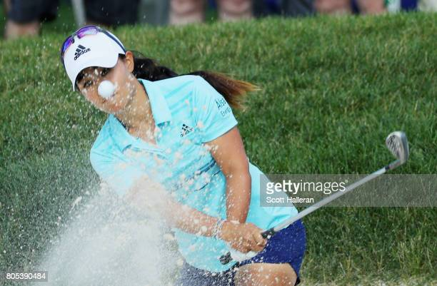 Danielle Kang plays a bunker shot on the 18th hole during the third round of the 2017 KPMG Women's PGA Championship at Olympia Fields Country Club on...