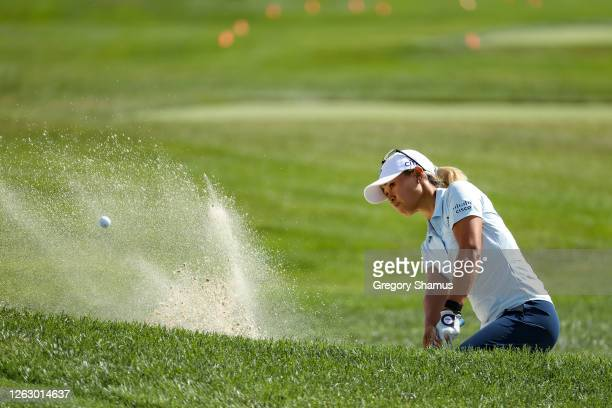 Danielle Kang plays a shot from a bunker on the second hole during the first round of the LPGA Drive On Championship at Inverness Club on July 31...