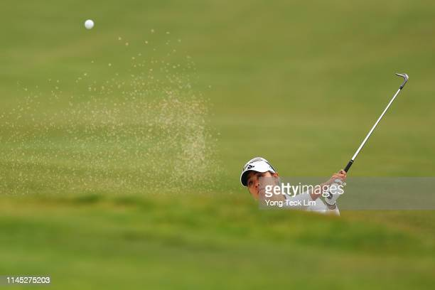 Danielle Kang plays her shot from a bunker on the 13th hole for an eagle during round two of the HUGELAIR PREMIA LA Open at Wilshire Country Club on...