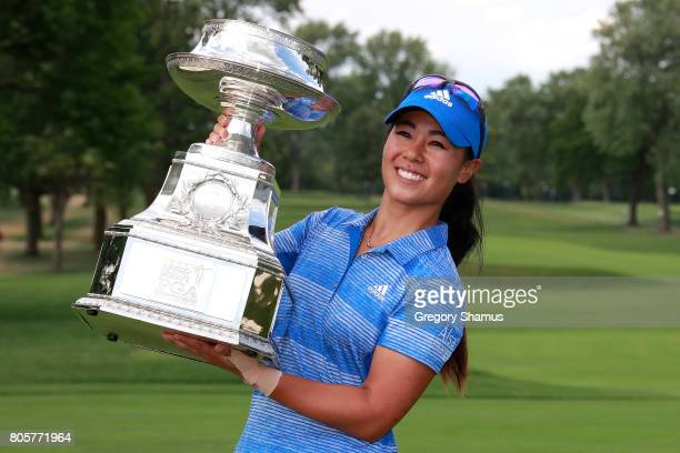 Danielle Kang poses with the championship trophy after winning the 2017 KPMG PGA Championship at Olympia Fields Country Club on July 2 2017 in...