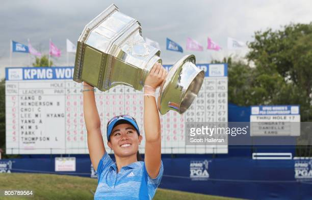 Danielle Kang poses with the trophy after winning the 2017 KPMG Women's PGA Championship at Olympia Fields Country Club on July 2 2017 in Olympia...
