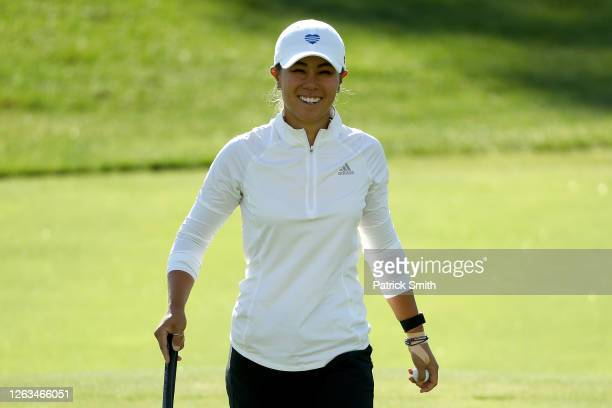Danielle Kang reacts after her par on the on the 15th green during the final round of the LPGA Drive On Championship at Inverness Club on August 2...