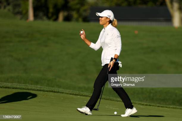 Danielle Kang retrieves her ball after putting for par on the 18th hole to win the LPGA Drive On Championship at Inverness Club on August 2 2020 in...