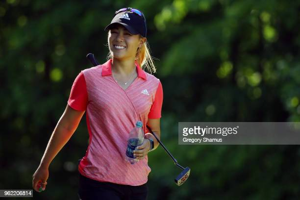 Danielle Kang smiles walking off of the seventh tee during the first round of the LPGA Volvik Championship on May 24 2018 at Travis Pointe Country...