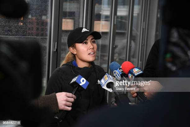 Danielle Kang speaks with reporters at the KPMG Women's PGA Championship National Media Day in River Point Park on May 14 2018 in Chicago Illinois