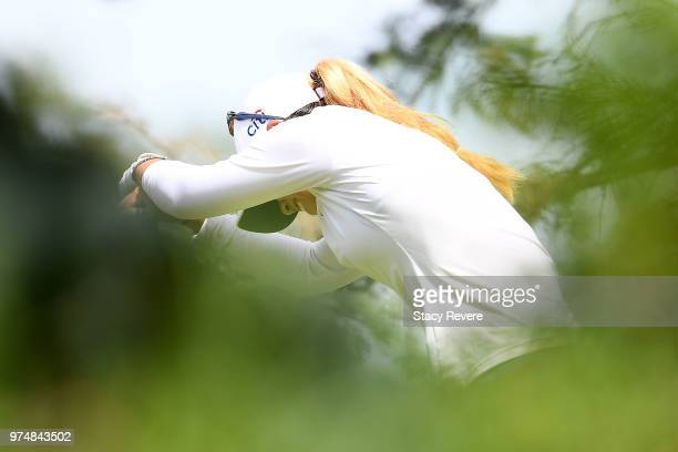 Danielle Kang struggles with an injury on the third tee during the first round of the Meijer LPGA Classic for Simply Give at Blythefield Country Club...