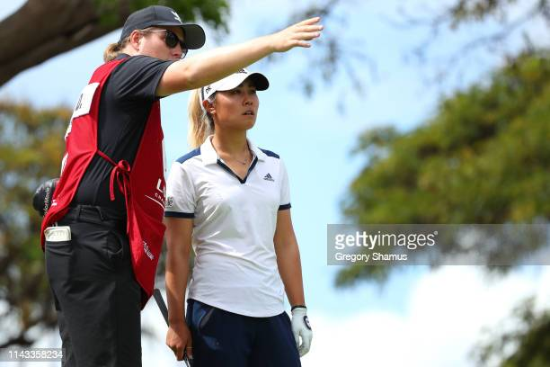 Danielle Kang talks to her caddie on the 17th tee during the first round of the Lotte Championship on April 18 2019 in Kapolei Hawaii