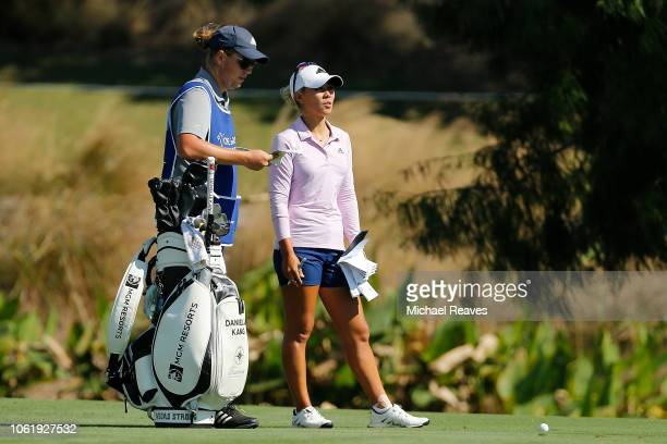 Danielle Kang talks with her caddie on the ninth hole during the first round of the CME Group Tour Championship at Tiburon Golf Club on November 15...