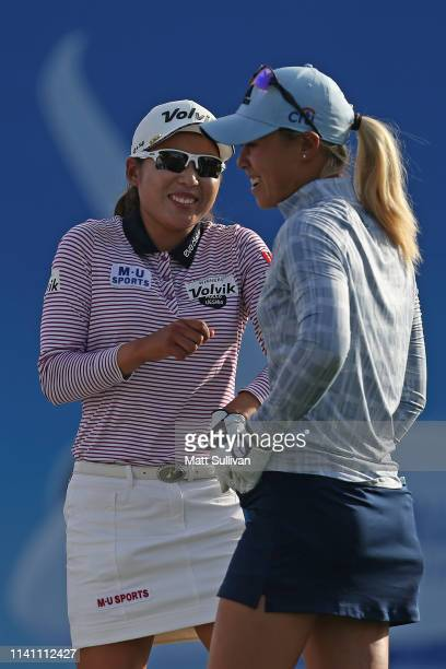 Danielle Kang talks with Mi Hyang Lee of South Korea on the 17th hole during the final round of the ANA Inspiration on the Dinah Shore course at...