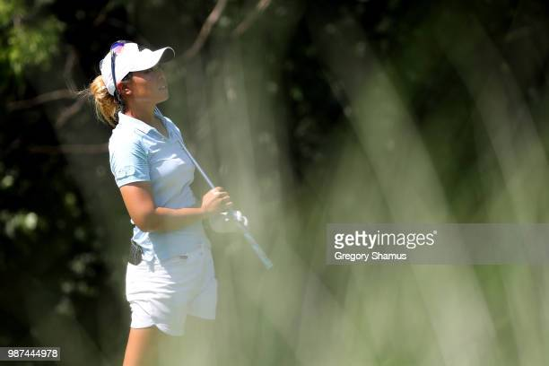 Danielle Kang watches her tee shot on the 17th hole during the second round of the 2018 KPMG PGA Championship at Kemper Lakes Golf Club on June 29...