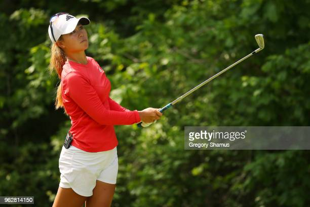 Danielle Kang watches her tee shot on the seventh hole during the third round of the LPGA Volvik Championship on May 26 2018 at Travis Pointe Country...