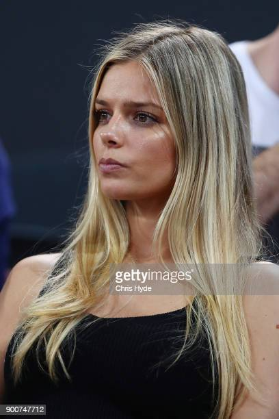 Danielle Knudson watches partner Milos Raonic of Canada play against Alex De Minaur of Australia during day four of the 2018 Brisbane International...