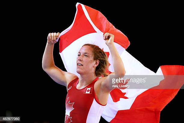 Danielle Lappage of Canada celebrates winning the gold medal in the Women's FS 63 kg at Scottish Exhibition and Conference Centre during day eight of...