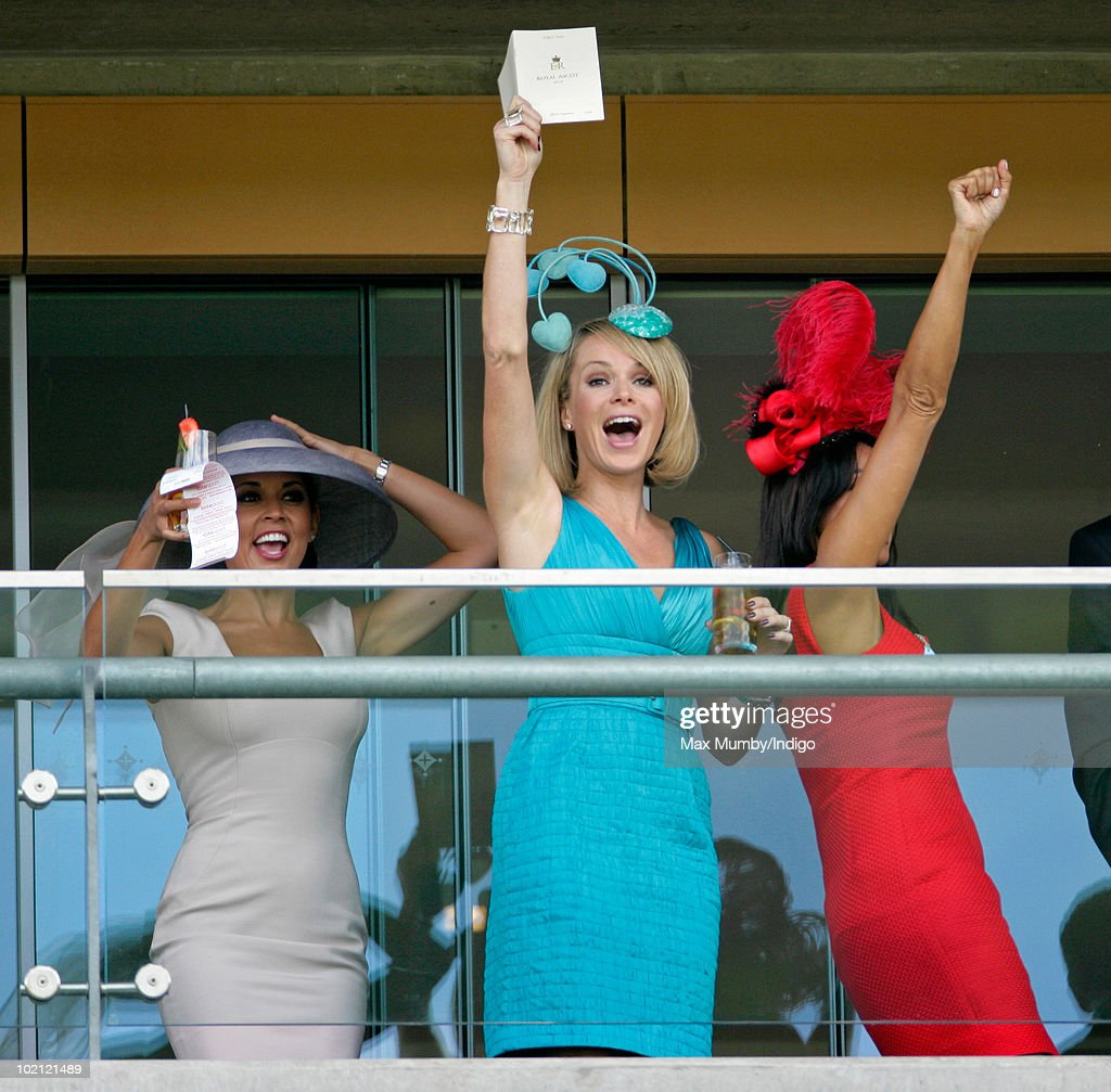 Danielle Lineker , Amanda Holden and Jackie St Claire cheer as they watch the horse racing from the balcony of their box on day one of Royal Ascot at Ascot Racecourse on June 15, 2010 in Ascot, England.
