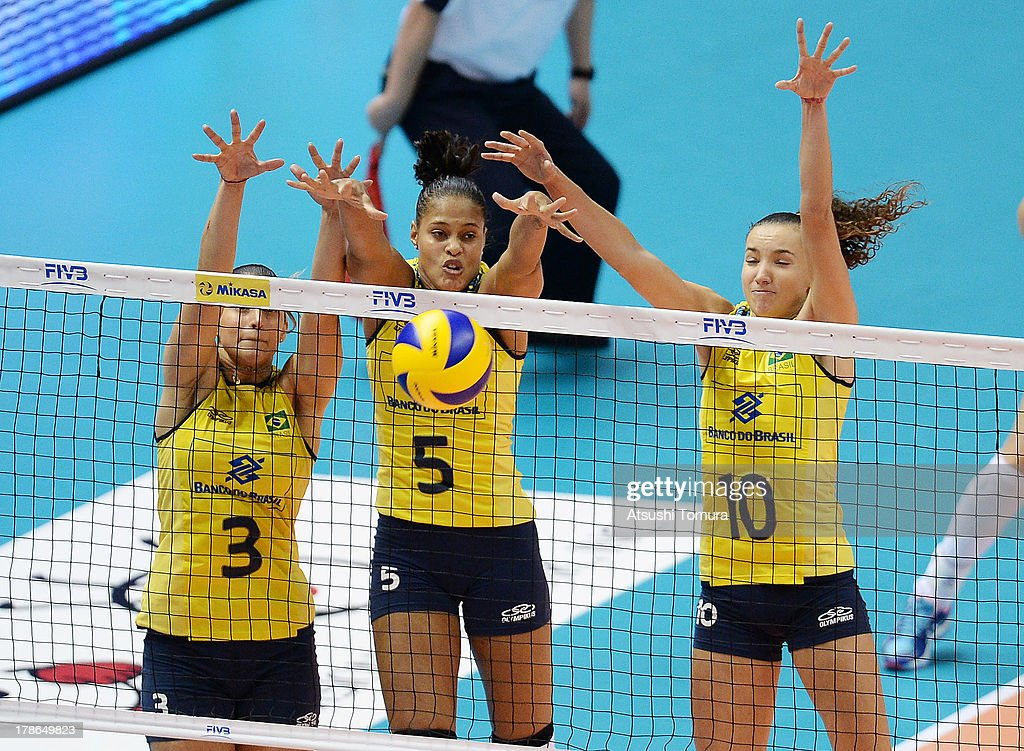 Danielle Lins, Adenizia Silva and Gabriela Guimaraes of Brazil blocks an attack during day three of the FIVB World Grand Prix Sapporo 2013 match between Brazil and Italy at Hokkaido Prefectural Sports Center on August 30, 2013 in Sapporo, Hokkaido, Japan.