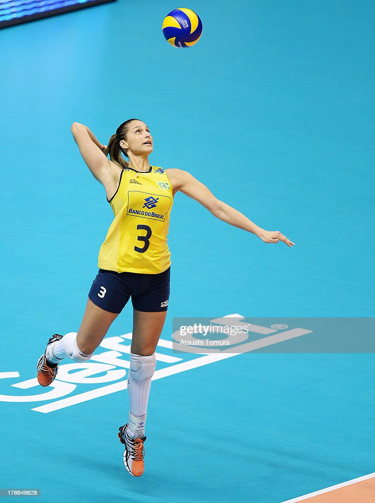 Danielle Lins of Brazil serves the ball during day three of the FIVB World Grand Prix Sapporo 2013 match between Brazil and Italy at Hokkaido Prefectural Sports Center on August 30, 2013 in Sapporo, Hokkaido, Japan.