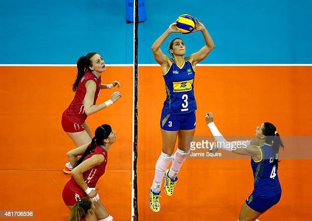 Danielle Lins sets for Ana Caroline Da Silva during the final round match against Russia on day 2 of the FIVB Volleyball World Grand Prix on July 23...